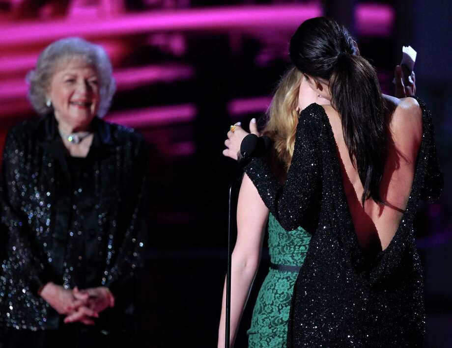 Sandra Bullock and Scarlett Johansson kiss onstage as actress Betty White looks on onstage at the 2010 MTV Movie Awards held at the Gibson Amphitheatre at Universal Studios  on June 6, 2010 in Universal City, California.  Sandra Bullock was honored with the MTV Generation Award. Photo: Christopher Polk, Getty Images / 2010 Getty Images