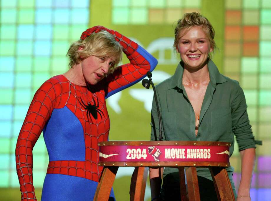 Presenters Ellen Degeneres and Kirsten Dunst on stage at the 2004 MTV Movie Awards at the Sony Pictures Studios on June 5, 2004 in Culver City, California. Photo: Kevin Winter, Getty Images / 2004 Getty Images