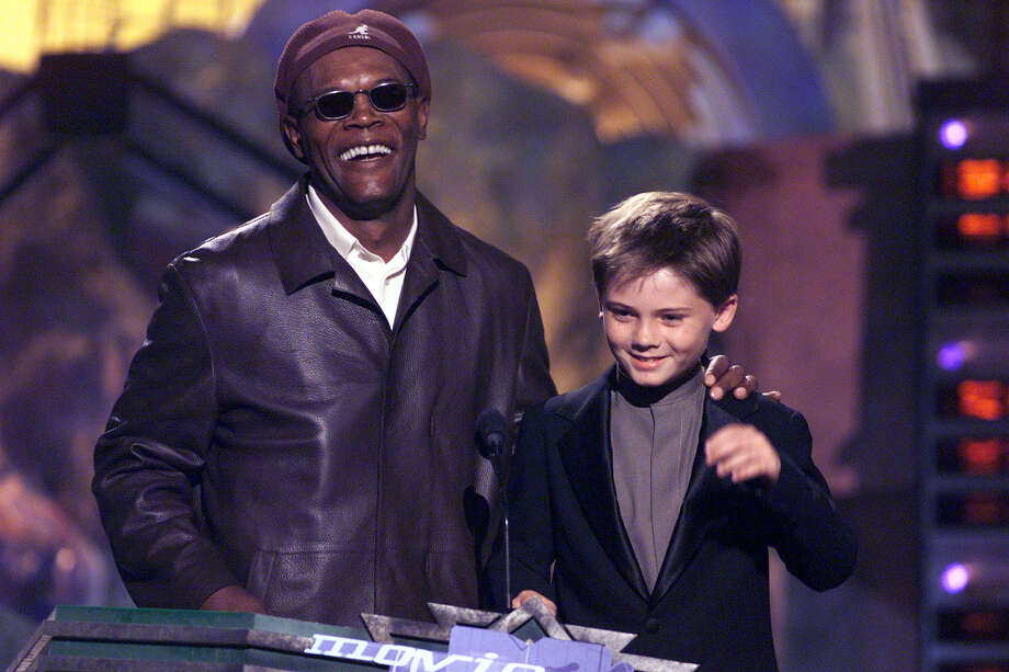 Presenters Samuel L. Jackson, and Jake Lloyd, aka young Anakin Skywalker, at the 1999 MTV Movie Awards at the Barker Hanger in Los Angeles, CA, 6/5/99. Photo: Frank Micelotta, Getty Images / Getty Images North America