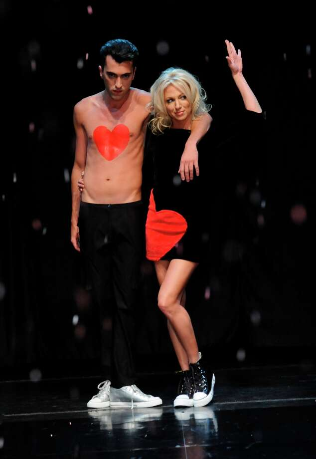 "Debbie Gibson and a model walk the runway at iiJin\'s Fall/Winter 2013 ""The Love Revolution\"" Clothing And Footwear Collection Fashion Show at Avalon on April 3, 2013 in Hollywood, California. Photo: Vivien Killilea, WireImage / 2013 Vivien Killilea"