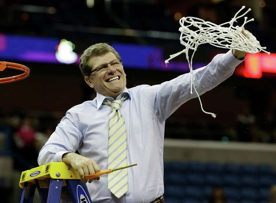 Connecticut head coach Geno Auriemma reacts after cutting the net down with Connecticut players celebrating after defeating Louisville 93-60 in the national championship game of the women's Final Four of the NCAA college basketball tournament, Tuesday, April 9, 2013, in New Orleans. Photo: Dave Martin