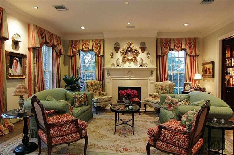 The formal living room is opulently adorned with a 10 ft for Living room with 10 foot ceiling