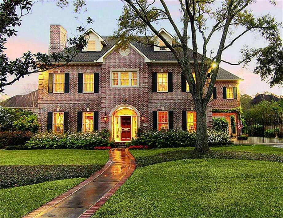 This stately, Georgian brick home exudes the style and quality for which the traditional Tanglewood home is renowned. Situated on a 14,250 sf lot (*) the curb appeal is undeniably magnificent. Photo: John Daugherty Realtors