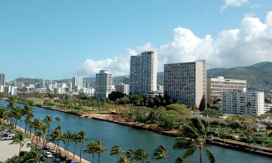 The Coconut Waikiki, now managed by Joie de Vivre Hotels under its own brand, offers views of the Ala Wai Canal, skyscrapers and the Ko'olau mountains.