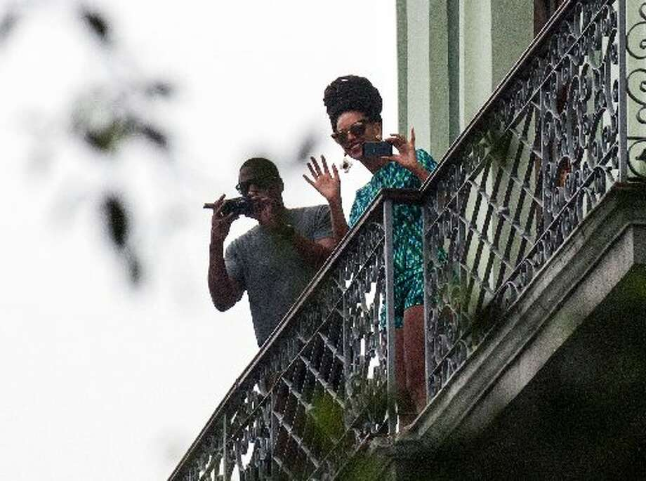 Jay-Z and Beyonce look down from their balcony.