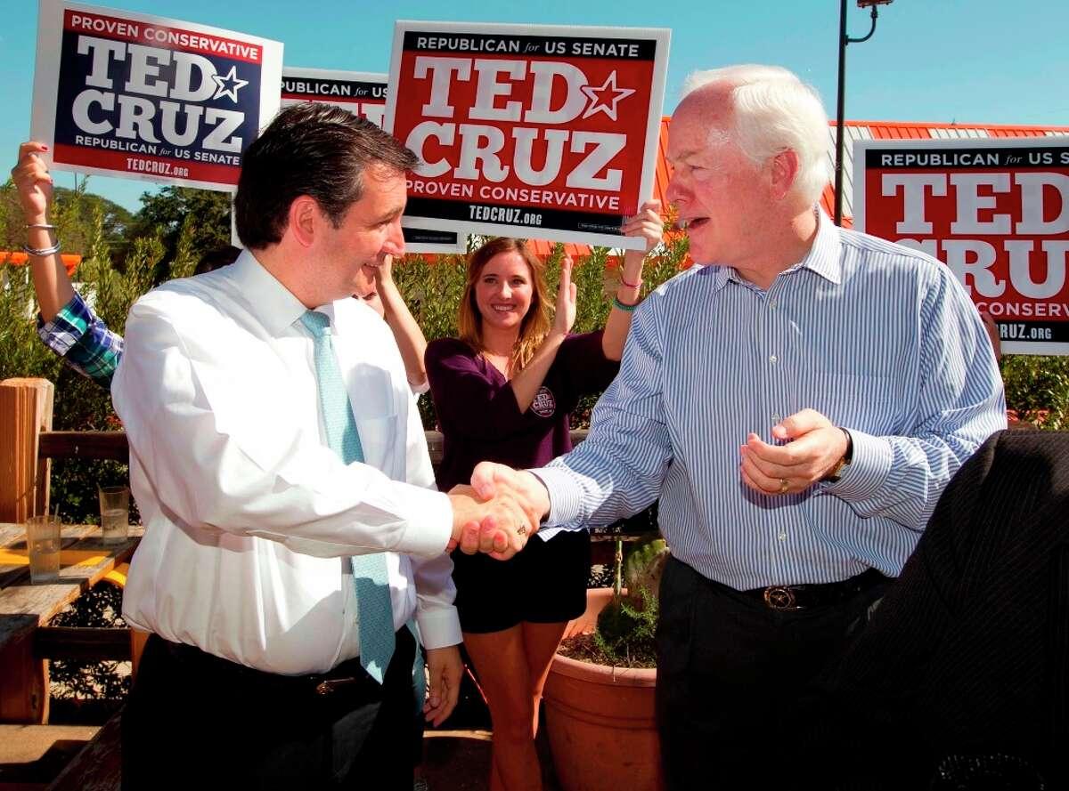 File - Sen. Ted Cruz shakes hands with Sen. John Cornyn at a rally at Maudie's Hacienda on Wednesday Oct. 31, 2012, in Austin, Texas. (AP Photo/Austin American-Statesman, Jay Janner)