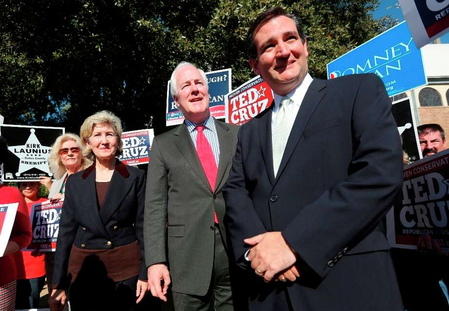 File - Sen. Ted Cruz, right, former U.S. Senator Kay Bailey Hutchison, left, and Sen. John Cornyn listen to a question from reporters outside a polling station in Dallas, Thursday, Nov. 1, 2012. Cruz faced Democratic candidate Paul Sadler for the U.S. Senate seat vacated by fellow Republican Hutchison. (AP Photo/LM Otero) Photo: LM Otero, Associated Press / AP