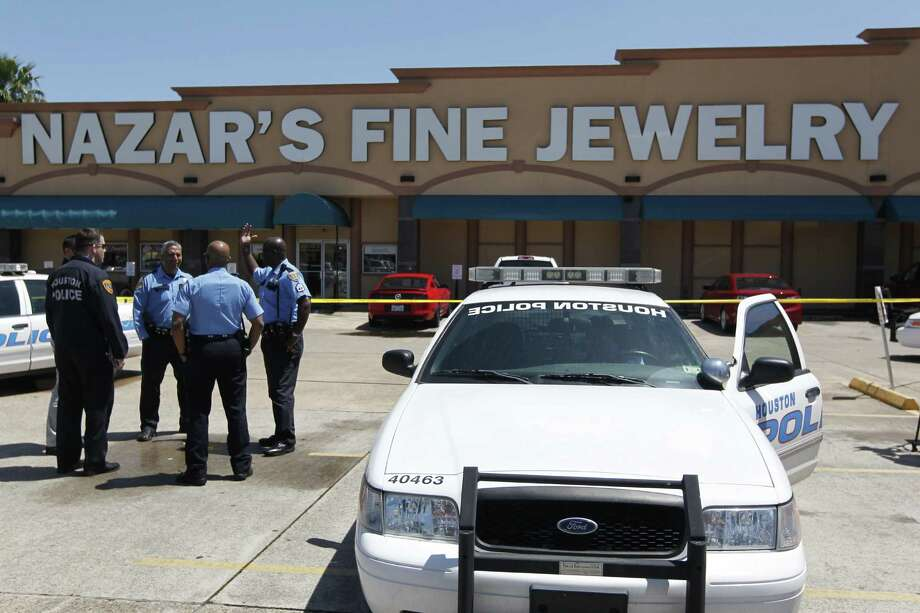 Houston police investigate a shooting at Nazar's Fine Jewelry, April 12. Photo: Houston Chronicle