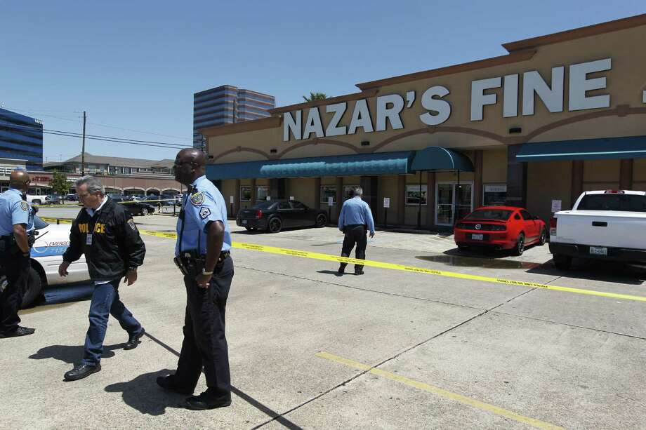 Houston police investigate a shooting at Nazar's Fine Jewelry on Thursday. Photo: Johnny Hanson
