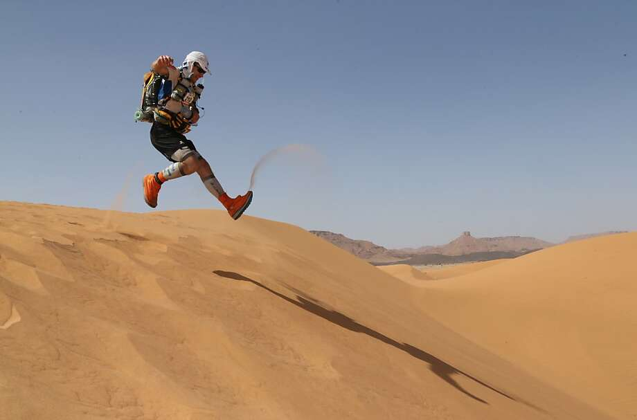 A competitor bounds downa Moroccan dune during the 28th edition of the Marathon des Sables, considered the most grueling in the world. More than 1,000 contestants, ages 20 to 76, must walk 140 miles over seven days in the Sahara south of Ouarzazate. They carry all their equipment and food on their backs. Photo: Pierre Verdy, AFP/Getty Images
