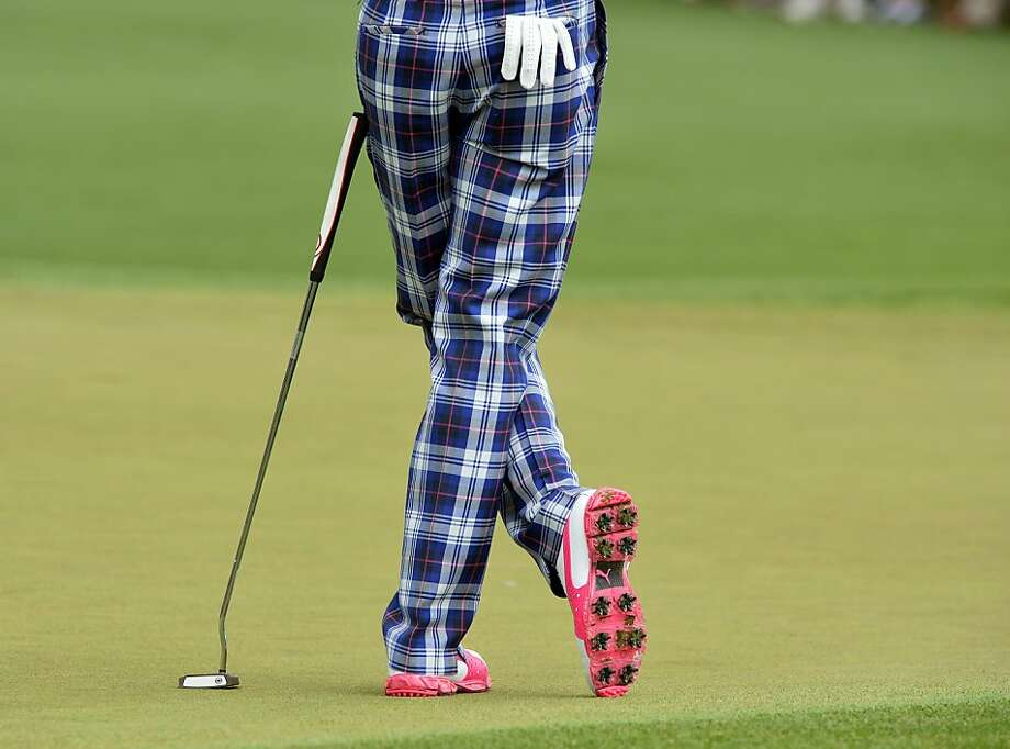 Poulter with a putter:England's Ian Poulter looks fab in plaid during the first round of the Masters at Augusta. Photo: Jewel Samad, AFP/Getty Images