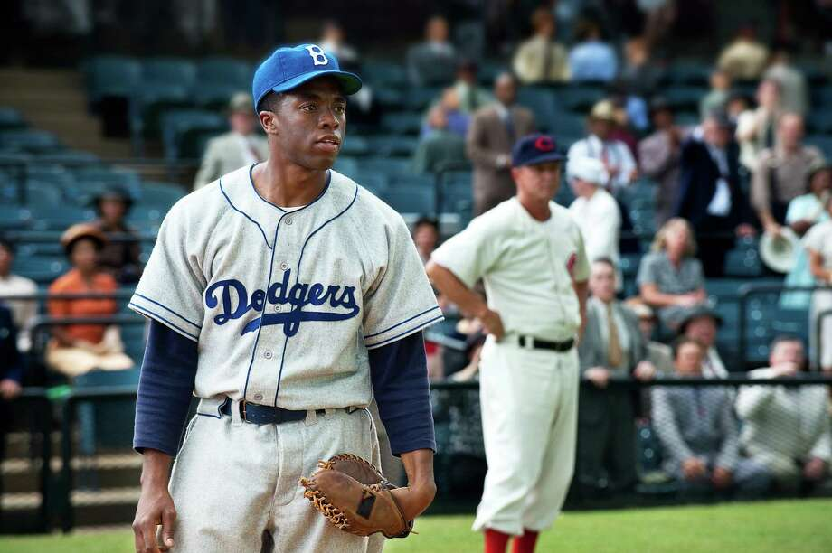 "This film image released by Warner Bros. Pictures shows Chadwick Boseman as Jackie Robinson in a scene from ""42.""  (AP Photo/Warner Bros. Pictures, D. Stevens) Photo: D. Stevens"