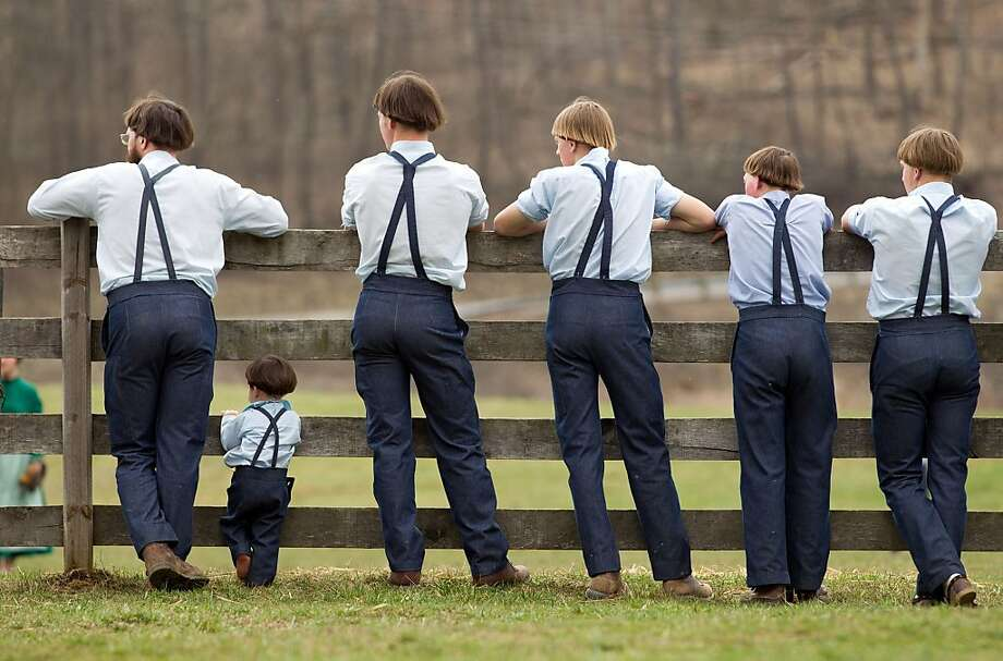 Where Amish schoolgirls are playing ball,one will also find Amish schoolboys. All with the same haircut. (Bergholz, Ohio.) Photo: Scott R. Galvin, Associated Press