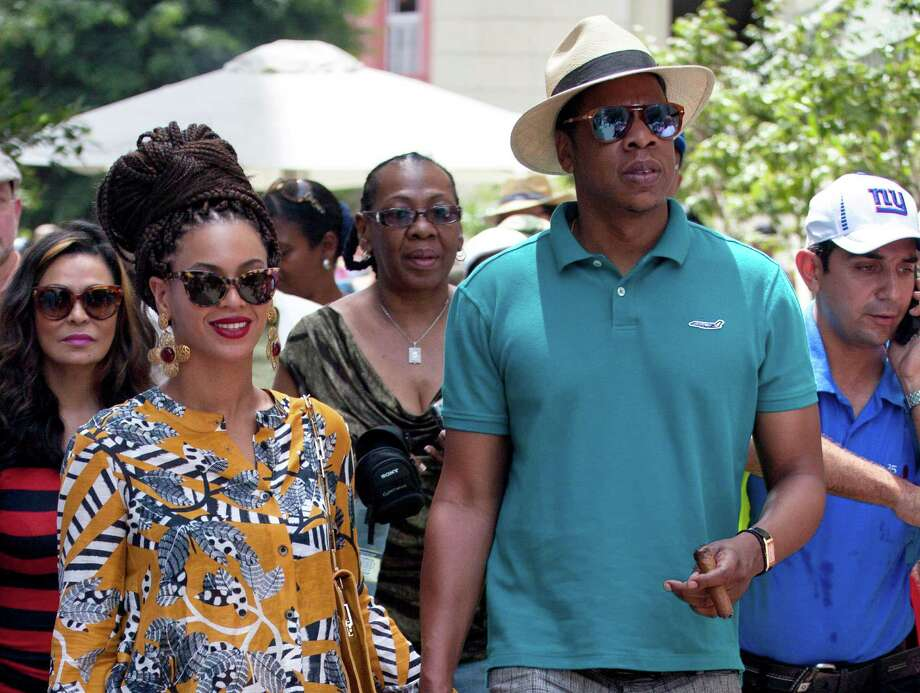 "FILE - This April 4, 2013 file photo shows married musicians Beyonce, left, and rapper Jay-Z as they tour Old Havana, Cuba. Jay-Z is addressing his recent trip to Cuba in a new song. The rapper released ""Open Letter"" Thursday, April 11, after two Florida Republicans questioned if the rapper's visit to Havana with wife Beyonce was officially licensed.  (AP Photo/Ramon Espinosa, file) Photo: Ramon Espinosa"