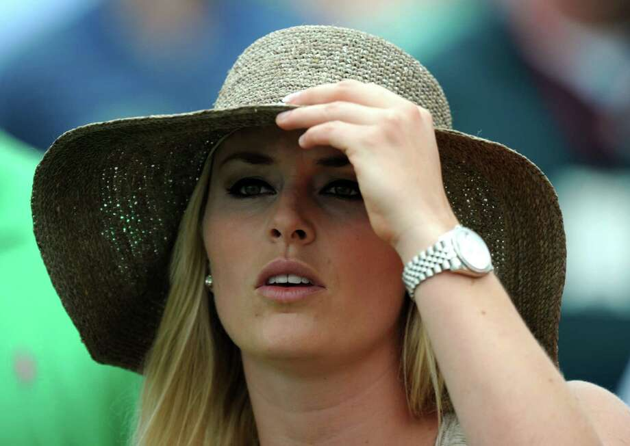 US Olympic skier Lindsey Vonn watches Tiger Woods of the US during the first round of the 77th Masters golf tournament at Augusta National Golf Club on April 11, 2013 in Augusta, Georgia.    AFP PHOTO /JIM WATSONJIM WATSON/AFP/Getty Images Photo: JIM WATSON, AFP/Getty Images / AFP