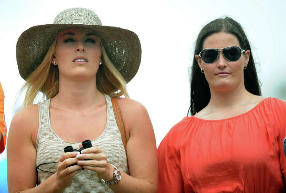 US Olympic skier Lindsey Vonn(L)  and her physical therapist Lindsay Winninger watch Tiger Woods of the US during the first round of the 77th Masters golf tournament at Augusta National Golf Club on April 11, 2013 in Augusta, Georgia.    AFP PHOTO /JIM WATSONJIM WATSON/AFP/Getty Images Photo: JIM WATSON, AFP/Getty Images / AFP