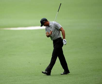 Tiger Woods of the US reacts to a shot during the first round of the 77th Masters golf tournament at Augusta National Golf Club on April 11, 2013 in Augusta, Georgia.    AFP PHOTO /JIM WATSONJIM WATSON/AFP/Getty Images Photo: JIM WATSON, AFP/Getty Images / AFP