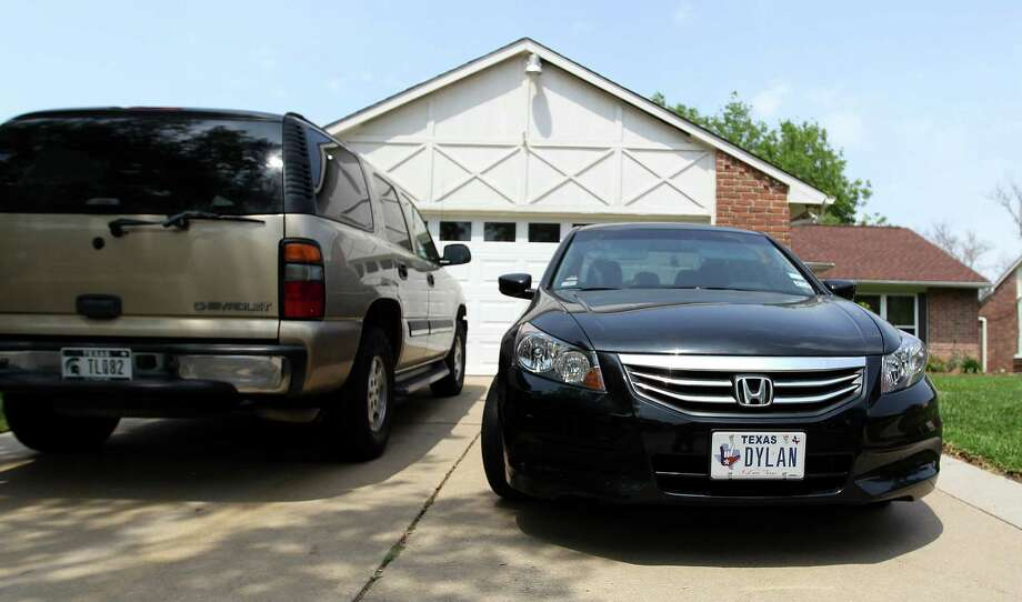 """A car with a """"Dylan"""" license plate is parked in front of a home in the 16000 block of Jenikay Street, Tuesday, April 9, 2013, in Houston, where the possible suspect in a mass stabbing incident at Lone Star College's Cypress-Fairlbanks campus, Dylan Quick, was reported to have lived. Photo: Karen Warren, Houston Chronicle / © 2013 Houston Chronicle"""