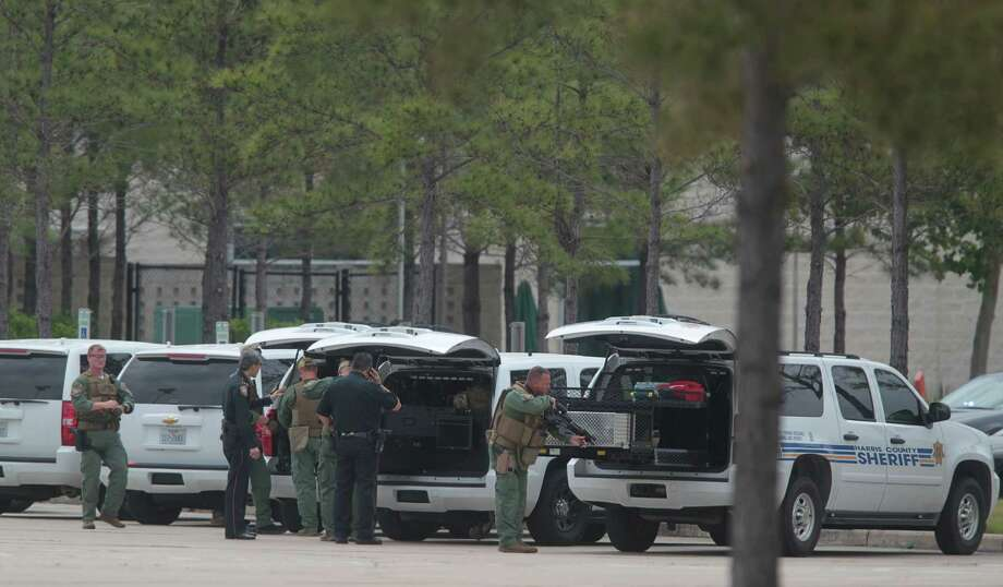 Harris County Sheriffs Officers prepare to enter the Health Science Center in the Cy-Fair campus of Lone Star College where 14 people were wounded in a stabbing on Tuesday, April 9, 2013, in Cypress. Photo: Mayra Beltran, Houston Chronicle / © 2013 Houston Chronicle