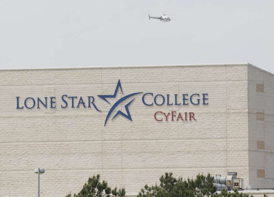 Police helicopter circles above the Cy-Fair campus of Lone Star College Tuesday, April 9, 2013. Photo: Melissa Phillip, Houston Chronicle