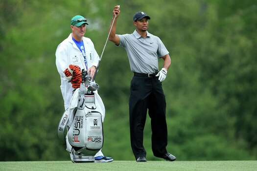 AUGUSTA, GA - APRIL 11:  Tiger Woods of the United States pulls out a club with caddie Joe LaCava before his second shot on the fifth hole during the first round of the 2013 Masters Tournament at Augusta National Golf Club on April 11, 2013 in Augusta, Georgia. Photo: David Cannon, Getty Images / 2013 Getty Images