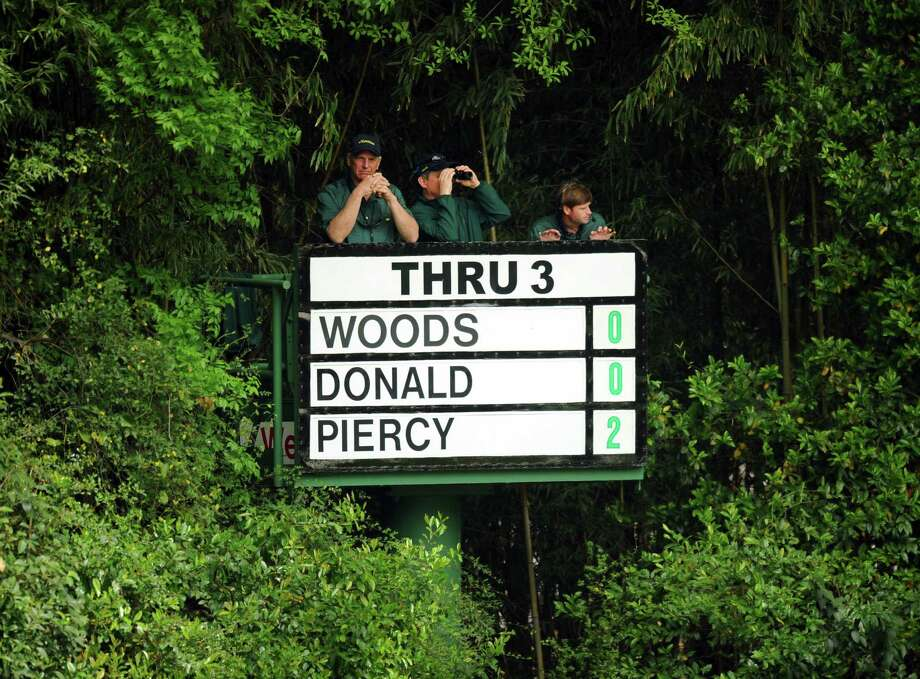 Scorekeepers watch the group including Tiger Woods of the US during the first round of the 77th Masters golf tournament at Augusta National Golf Club on April 11, 2013 in Augusta, Georgia.    AFP PHOTO / JIM WATSONJIM WATSON/AFP/Getty Images Photo: JIM WATSON, AFP/Getty Images / AFP