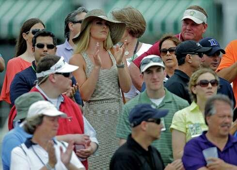 Skier Lindsey Vonn applauds as she watches Tiger Woods  during the first round of the Masters golf tournament Thursday, April 11, 2013, in Augusta, Ga. (AP Photo/Matt Slocum) Photo: Matt Slocum, Associated Press / AP