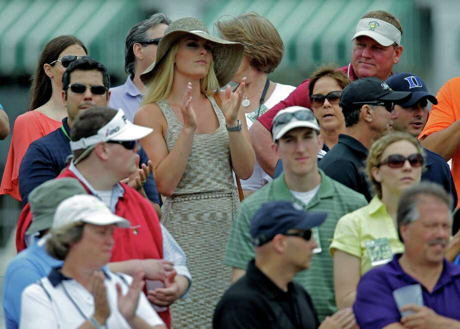 Skier Lindsey Vonn applauds as she watches Tiger Woods  during the first round of the Masters golf tournament Thursday, April 11, 2013, in Augusta, Ga. (AP Photo/Matt Slocum) Photo: Matt Slocum, Associated Press / AP