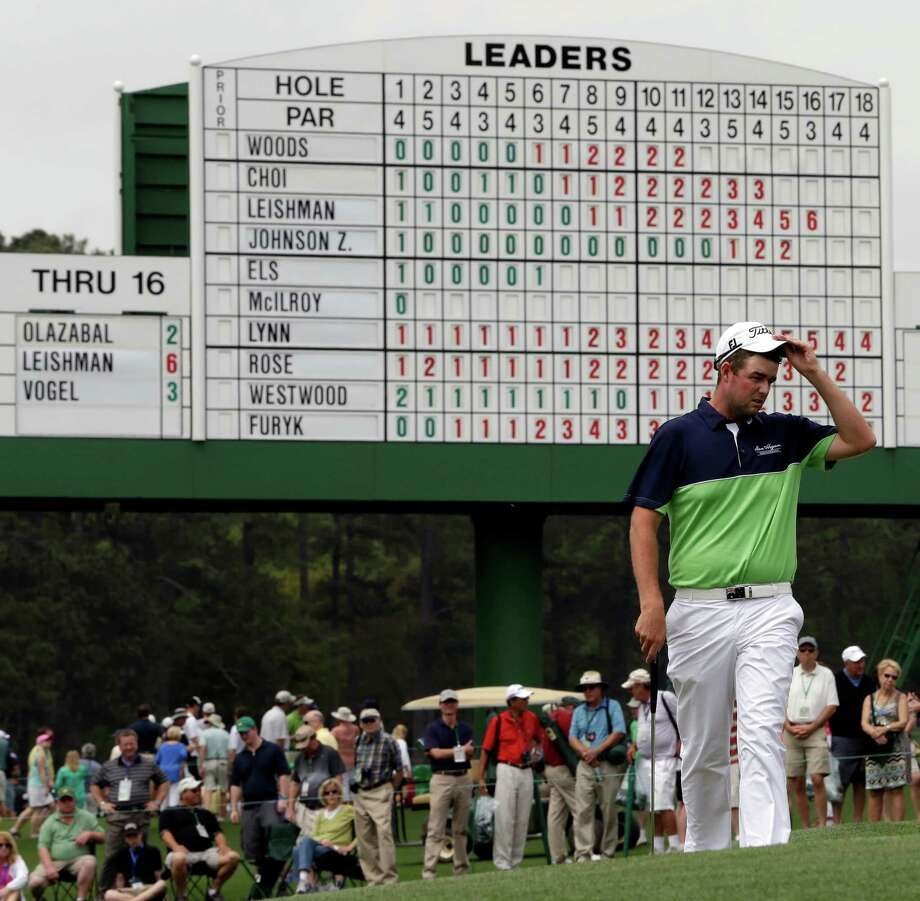 Marc Leishman, of Australia, raises his cap before putting on the 17th green during the first round of the Masters golf tournament Thursday, April 11, 2013, in Augusta, Ga. (AP Photo/David J. Phillip) Photo: David J. Phillip, Associated Press / AP