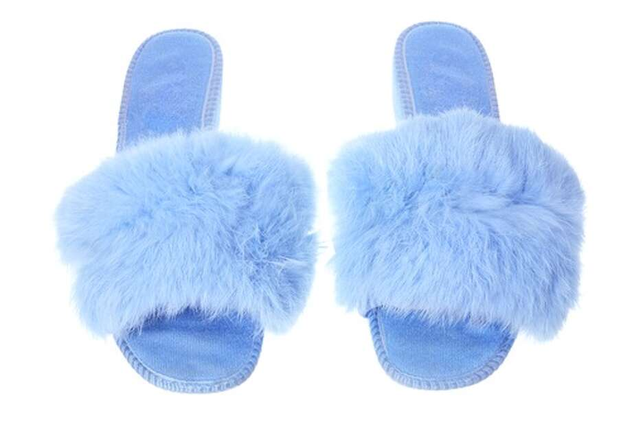 BEDROOM SLIPPERS. Many school districts, such as Perquimans County Schools in North Carolina, won't allow kids to scuffle around school in fuzzy slippers, reports the Daily Advance. Schools also commonly forbid pajamas. Photo: Photosync / Shutterstock