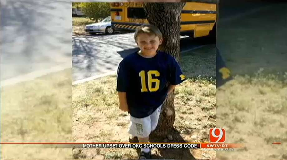 OUT-OF-STATE T-SHIRTS:In 2012, Cooper Barton, 5, was asked to turn his University of Michigan T-shirt inside-out. The dress code for Oklahoma City Public Schools allows students to wear only Oklahoma college apparel, according to News 9. Photo: News 9