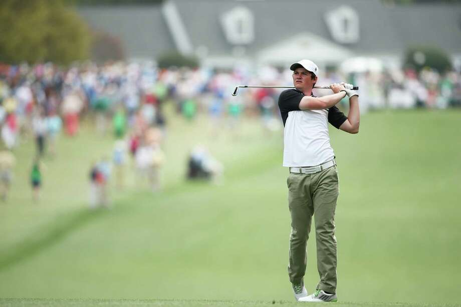 AUGUSTA, GA - APRIL 11:  Alan Dunbar of Northern Ireland hits his second shot on the first hole during the first round of the 2013 Masters Tournament at Augusta National Golf Club on April 11, 2013 in Augusta, Georgia. Photo: Andrew Redington, Getty Images / 2013 Getty Images