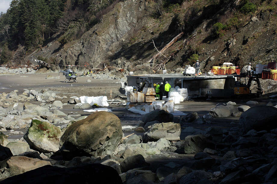 Crews work to dismantle the 180-ton dock from Japan that washed out to sea in the 2011 tsunami. Dock removal began on March 17 and was completed by March 28. Photo: Courtesy Of The National Park Service