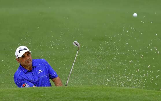 Angel Cabrera, of Argentina, chips out of a bunker on the second green during the first round of the Masters golf tournament Thursday, April 11, 2013, in Augusta, Ga. (AP Photo/David Goldman) Photo: David Goldman, Associated Press / AP