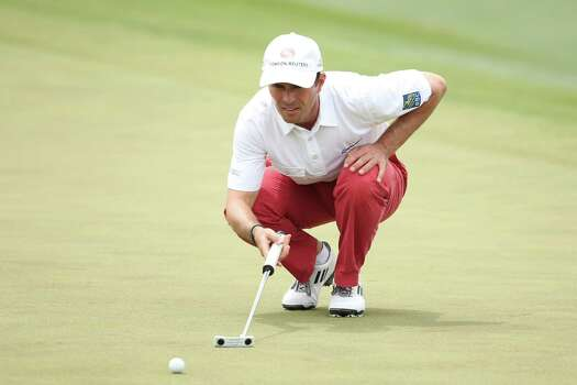 AUGUSTA, GA - APRIL 11:  Mike Weir of Canada lines up a putt on the 18th hole during the first round of the 2013 Masters Tournament at Augusta National Golf Club on April 11, 2013 in Augusta, Georgia. Photo: Andrew Redington, Getty Images / 2013 Getty Images