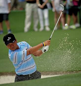K.J. Choi, of South Korea, chips out of a bunker on the 17th green during the first round of the Masters golf tournament Thursday, April 11, 2013, in Augusta, Ga. (AP Photo/David J. Phillip) Photo: David J. Phillip, Associated Press / AP