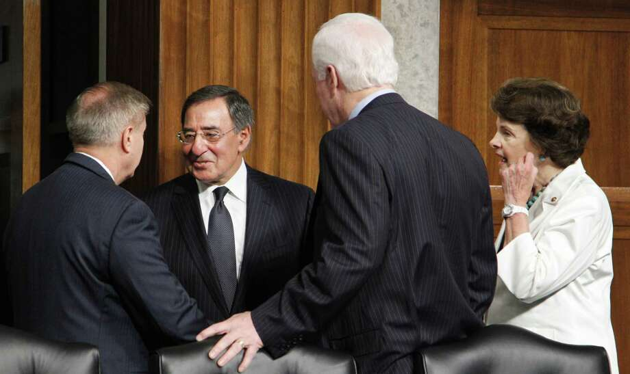 In this file photo, Defense Secretary of Defense nominee, CIA Director Leon Panetta, is greeted on Capitol Hill in Washington by Sen. John Cornyn as he arrived to testify before a Senate Armed Service Committee hearing on his nomination on June 9, 2011 Photo: Manuel Balce Ceneta, The Associated Press / AP