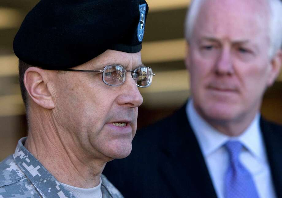 Brigadier General Frank Turner addresses the media and Army personnel with John Cornyn about the recent trend of suicides in the Battalion and averting future tragedies, at the River Oaks Recruiting Station Friday, Feb. 20, 2009, in Houston. Photo: Johnny Hanson, Houston Chronicle / Houston Chronicle