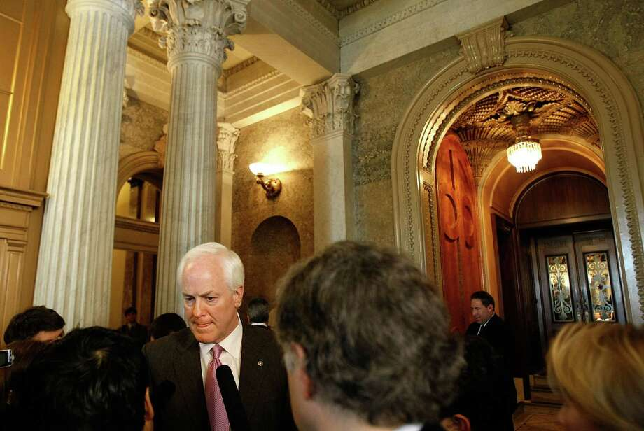 Sen. John Cornyn talks with reporters after a series of amendment votes on the economic stimulus legislation in the U.S. Capitol Feb. 6, 2009 in Washington, DC. Photo: Chip Somodevilla, Getty Images / Getty Images North America