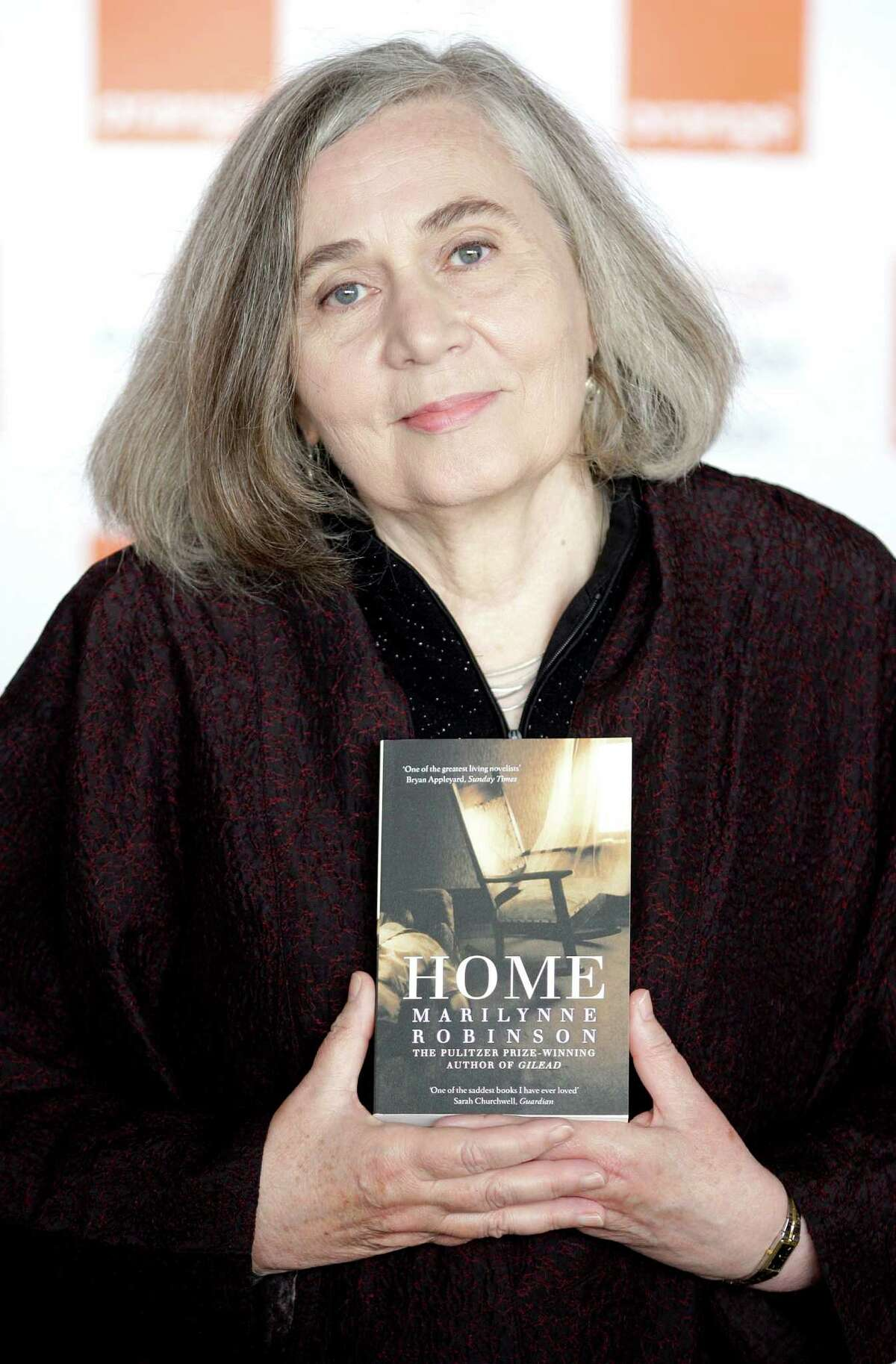 US author Marilynne Robinson poses for photographs with her book 'Home' at the Royal Festival Hall in central London on June 3, 2009, ahead of the Orange Prize for Fiction 2009 Award Ceremony. AFP PHOTO/Shaun Curry (Photo credit should read SHAUN CURRY/AFP/Getty Images)
