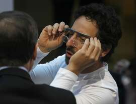 Google co-founder Sergey Brin adjusts a pair of Google Glass during an announcement of the launch of the Breakthrough Prize in Life Sciences and the award's first recipients at the UCSF Mission Bay campus in San Francisco, Calif. on Wednesday, Feb. 20, 2013.