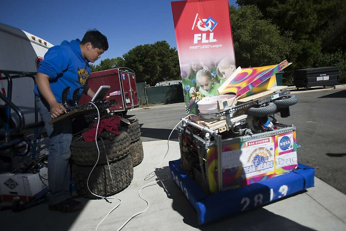 Shane Li, 15, a sophomore at Prospect High School and member of its Gear Heads robotic club, prepares to launch frisbees from a robot during Silicon Valley Robot Block Party 2013 at Automotive Innovation Facility in Stanford, Calif. on Wednesday, April 10, 2013.