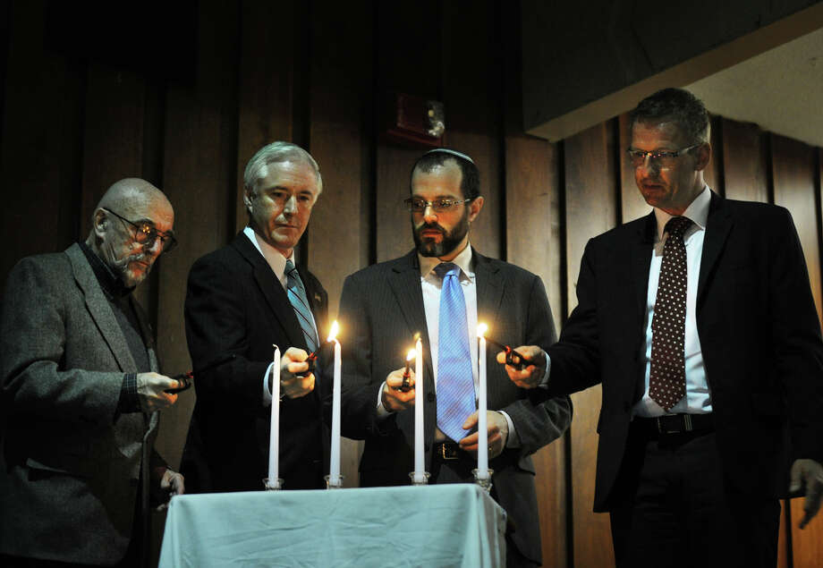 From left; Holocaust survivor Harry Weichsel of Bridgeport, Bridgeport Mayor Bill Finch, Rabbi Daniel Victor Sholom, and Wetter, Germany Mayor Kai-Uwe Spanka, light candles during the Holocaust Commemoration program at Central High School in Bridgeport, Conn. on Thursday, April 11, 2013. Photo: Brian A. Pounds / Connecticut Post