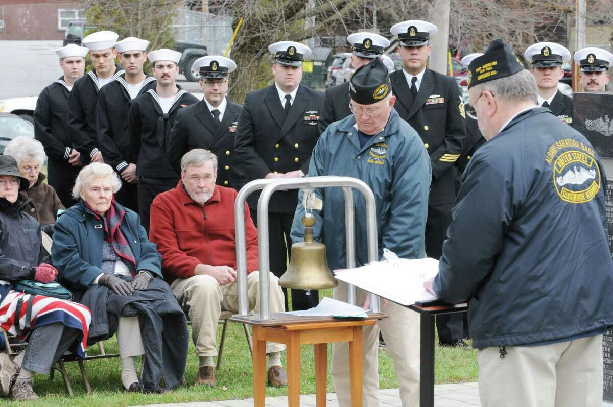 Veteran Tom Glenn rings a bell as James Irwin, commander of Albany-Saratoga Submarine Veterans, reads the names of the submariners who died at sea during a Tolling The Boats ceremony on Thursday, April 11, 2013 in Ballston Spa, N.Y. Thursday marks the 113th anniversary of the United States submarine service. (Lori Van Buren / Times Union)