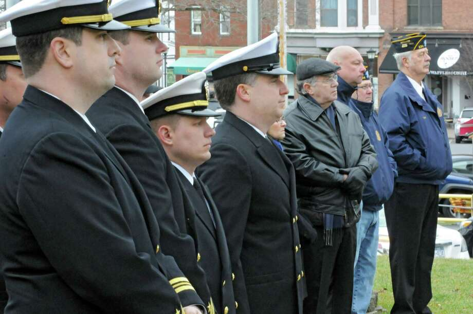 Servicemen and veterans listen as veteran Tom Glenn rings a bell and James Irwin, commander of Albany-Saratoga Submarine Veterans, reads the names of the submariners who died at sea during a Tolling The Boats ceremony on Thursday, April 11, 2013 in Ballston Spa, N.Y. Thursday marks the 113th anniversary of the United States submarine service. (Lori Van Buren / Times Union) Photo: Lori Van Buren