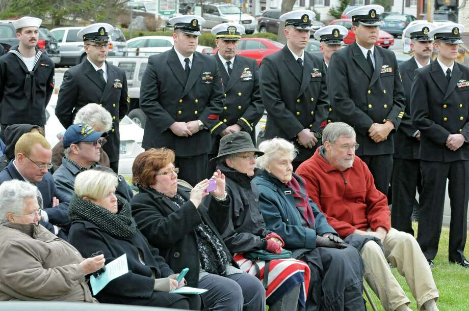 Family members, servicemen and veterans listen as veteran Tom Glenn rings a bell and James Irwin, commander of Albany-Saratoga Submarine Veterans, reads the names of the submariners who died at sea during a Tolling The Boats ceremony on Thursday, April 11, 2013 in Ballston Spa, N.Y. Thursday marks the 113th anniversary of the United States submarine service. (Lori Van Buren / Times Union) Photo: Lori Van Buren