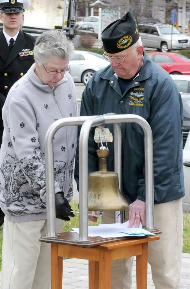 Lois Anderson of South Glens Falls, the widow of Lynn Saville of the USS Scorpion, rings the bell as James Irwin, commander of Albany-Saratoga Submarine Veterans, reads the names of the submariners who died at sea during a Tolling The Boats ceremony on Thursday, April 11, 2013 in Ballston Spa, N.Y. Veteran Tom Glenn stands to the right. Thursday marks the 113th anniversary of the United States submarine service. (Lori Van Buren / Times Union) Photo: Lori Van Buren