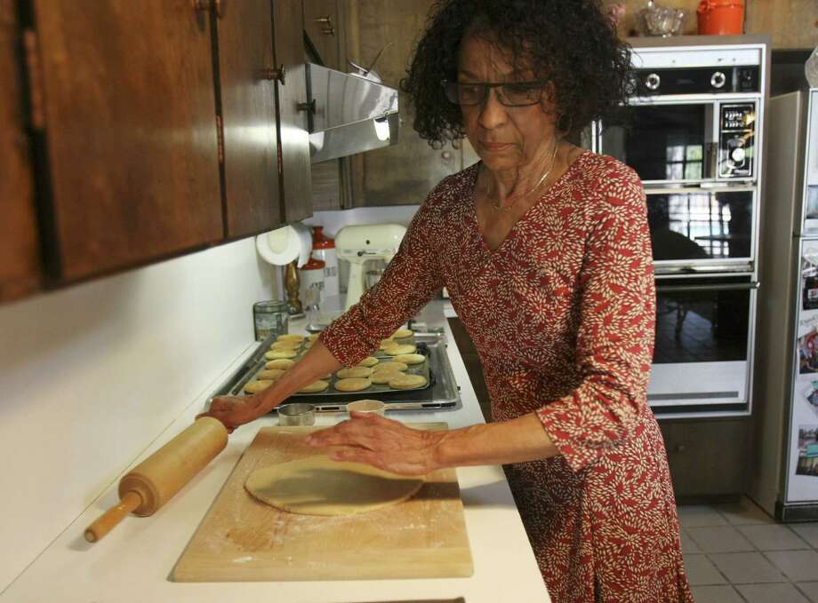 Gloria Bryant, called the Tea Cake Lady at Second Baptist Church, rolls out another piece of dough for tea cakes in her kitchen. Her recipe came from her great-grandmother through Bryant's mother. Photo: Photos By Helen L. Montoya / San Antonio Express-News