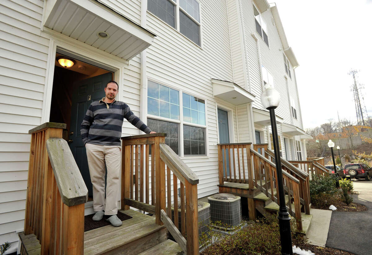 Ross Yachkoff shows off his newly purchased condominium unit in Norwalk on Tuesday, March 26, 2013. He moved into his condo in January. This is Yachkoff's first home purchase.