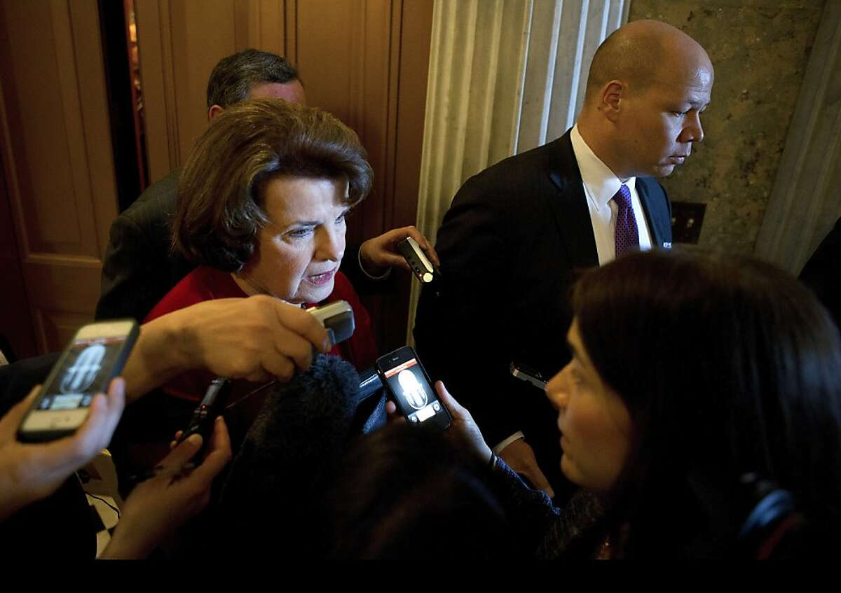 Sen. Dianne Feinstein (D-Calif.) talks to reporters after voting on gun-control legislation in Washington, April 11, 2013. Lawmakers on Thursday thwarted a threatened filibuster, clearing the way for debate on the first piece of major gun control legislation to be considered in the Senate in decades. (Doug Mills/ The New York Times)